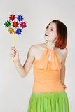 Girl in bright clothes holding pinwheel Stock Image