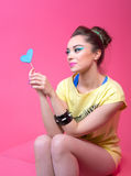 Girl in bright clothes on a pink background, retro style. Stock Photos