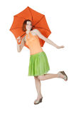 Girl in bright clothes with umbrella. Young girl in bright clothes standing on one leg with umbrella, isolated Royalty Free Stock Photo