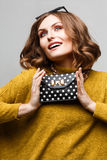 girl in a bright dress with clutch bag polka dots Stock Image