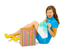 Girl in a bright dress with shopping Royalty Free Stock Photos