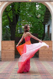 Girl in a bright evening gown Stock Photos