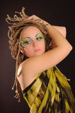 Girl with bright exotic makeup. Braids and sequins Royalty Free Stock Images