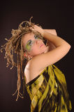 Girl with bright exotic makeup. Braids and sequins Royalty Free Stock Photos