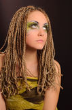 Girl with bright exotic makeup. Braids and sequins Royalty Free Stock Image