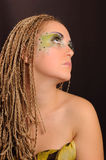 Girl with bright exotic makeup. Braids and sequins Stock Photography