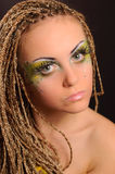 Girl with bright exotic makeup. Braids and sequins Stock Photo