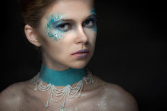 Girl with bright fashion make-up. The girl with bright fashion make-up and sparkles stock photo