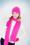Girl in bright hat and scarf Royalty Free Stock Photos