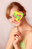 Girl with Bright Lollipop Royalty Free Stock Image