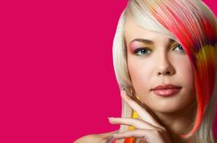 Girl with a bright make-up and multi-coloured strand in hair Stock Images