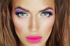 A girl with bright makeup. Doll girl make-up  bright  color  eyes Royalty Free Stock Image