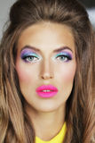 A girl with bright makeup. Doll girl make-up  bright  color  eyes Royalty Free Stock Photography