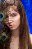 Girl with bright  makeup and peacock feathe Stock Image
