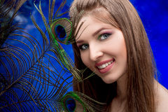 Girl with bright  makeup and peacock feathe Stock Photo