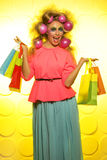 Girl with bright makeup and purchase in hands Stock Image
