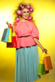 Girl with bright makeup and purchase in hands Stock Photos