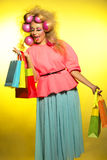 Girl with bright makeup and purchase in hands Stock Images