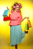 Girl with bright makeup and purchase in hands Stock Photography