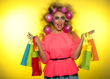 Girl with bright makeup and purchase in hands Royalty Free Stock Image