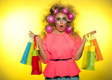 Girl with bright makeup and purchase in hands Royalty Free Stock Photo
