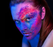 A girl with bright makeup unusual body painting Stock Image