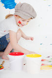 Girl with bright paints Royalty Free Stock Photo