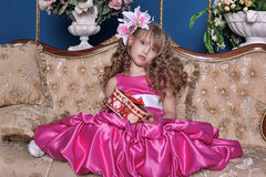 Girl in a bright pink dress Stock Image