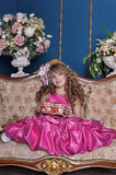 Girl in a bright pink dress Stock Photography