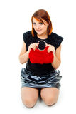 Girl with the bright red bag sits Royalty Free Stock Photo