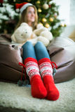 Girl in bright red Christmas socks Royalty Free Stock Photos