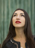 Girl with bright red lips looks upwards Stock Image