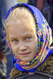 The girl in the bright shawl Stock Photography
