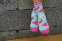 Girl in bright socks Royalty Free Stock Photography