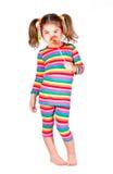 Girl in bright striped dress Stock Image