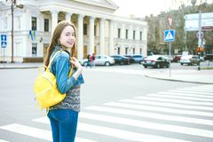 Girl with  bright stylish yellow backpack royalty free stock photo