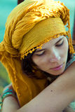 Girl in bright turban Stock Image