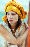 Girl in bright turban Stock Photography