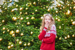 Girl with a brightly decorated Christmas tree Stock Photos