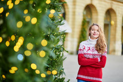 Girl with a brightly decorated Christmas tree Stock Images