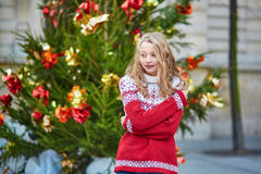 Girl with a brightly decorated Christmas tree Royalty Free Stock Image