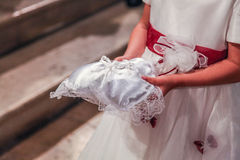 Girl bringing rings. A girl bringing rings to bride and groom at the church Royalty Free Stock Photo