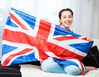 Girl with british flag. British girl holding the Jack Union flag royalty free stock image