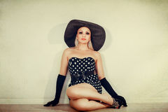 Girl in a broad-brimmed hat looking up Royalty Free Stock Images