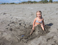Girl broke her sand castle Royalty Free Stock Photography