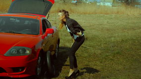 Girl broke the wheel of the car stock video footage