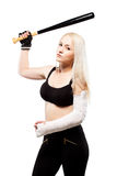 Girl with a broken arm holding baseball bat Royalty Free Stock Images