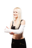 Girl with a broken arm making like gesture Royalty Free Stock Photography
