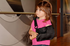 Girl with a broken arm Stock Images