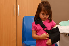 Girl with a broken arm Royalty Free Stock Image